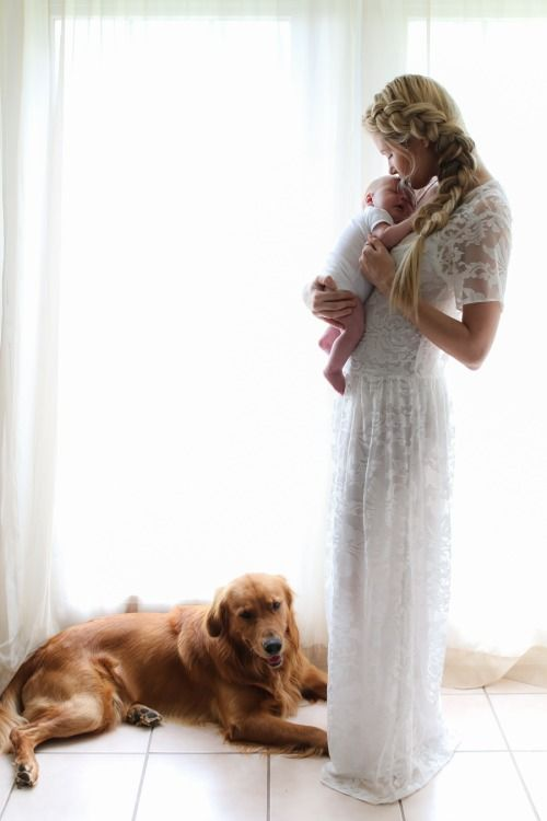 New mom with newborn and dog.