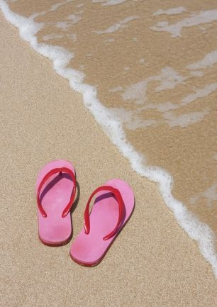 I wear flip-flops when I go to the beach or when I play volleyball. They're easy to slip on and off and they come in a variety of colours so you can match your sandals with any outfit. Other than beach and volleyball, I stay away from flip-flops as I will inadvertently kick all sorts of debris up my legs.