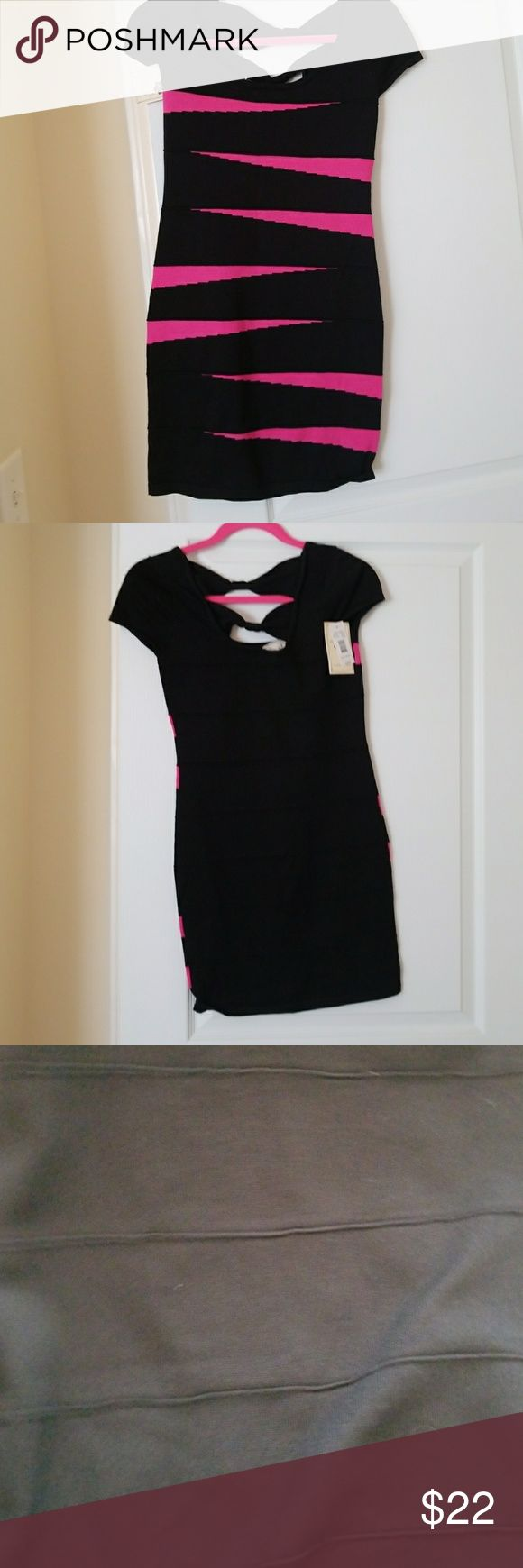 "Pink Rose hot pink and black dress size XS Pink Rose hot pink and black dress size XS. Very stretchy.  Round neckline with bow details on back. Perfect for a night out! Never worn, still has tags. For reference I am 135 lbs, 5'7"" and it's just too small for me. Pink Rose Dresses Mini"