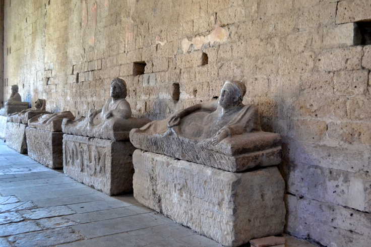 Etruscans waiting for the resurrection in San Pietro, Tuscania, Italy