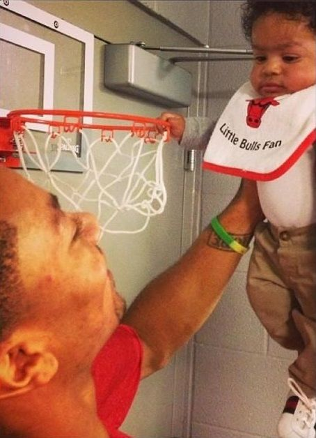 Like father, like son. Here's recovering Chicago Bulls superstar Derrick Rose showing his son's uncanny ability to grab rim — P.J. Rose might just be the best basketball player in the world under 2 years old.-TO