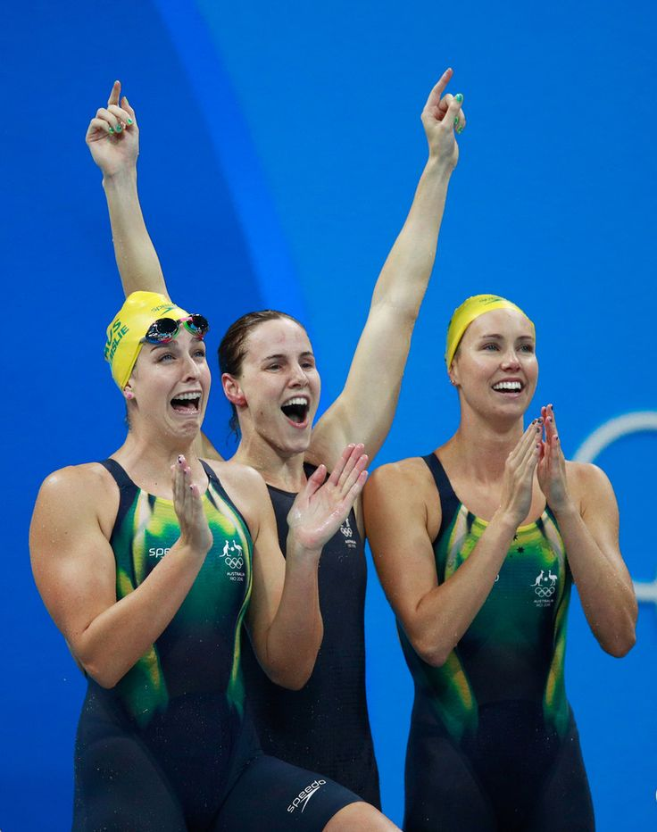 Emma McKeon, Brittany Elmslie and Bronte Campbell of Australia celebrate winning gold and a new world record in the Final of the Women's 4 x 100m Freestyle Relay on Day 1 of the Rio 2016 Olympic Games at the Olympic Aquatics Stadium on August 6, 2016 in Rio de Janeiro, Brazil. (Source: Adam Pretty/Getty Images South America)