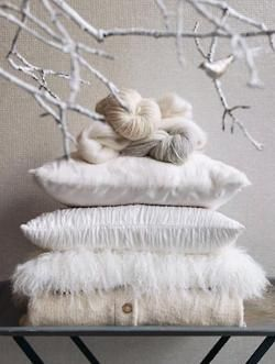 Have a cozy couch in your studio? Make it relevant to the season with textured pillows in the same color pallet.