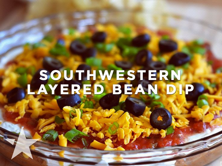 Lighten up your game day menu! Add this Southwestern Layered Bean Dip for a snack full of flavor but not on calories! #fitfuel