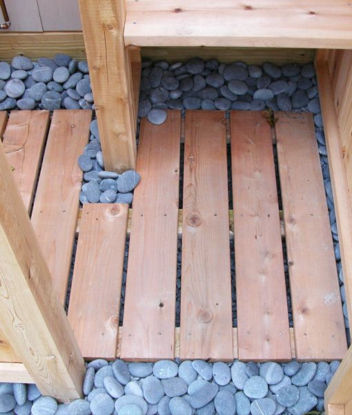 We highly recommend genuine Mexican Beach Pebbles under your outdoor shower floor. Not only do they look nice, but they are excellent for drainage.