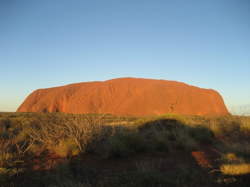 Sunburnt Ayers Rock against a magnificent blue sky.  Picture taken on the 1st May, 2009 at 8:27pm.
