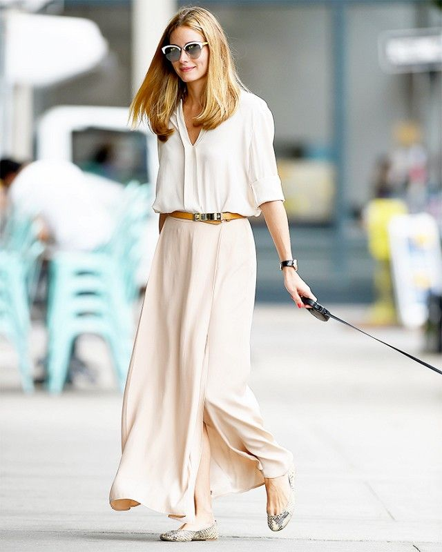 Olivia Palermo is wearing a white blouse with a nude skirt, brown belt, flats and cat-eye sunglasses. Celebrity style.   @WhoWhatWear