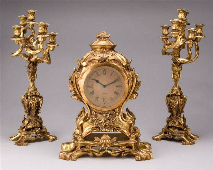 Antique gilt clock, and candelabra set so you can see what time it was back in the olden days :)