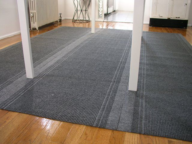 How to make a really cheap area rug using runners from Home Depot.  I may be trying this...  Rugs are expensive.