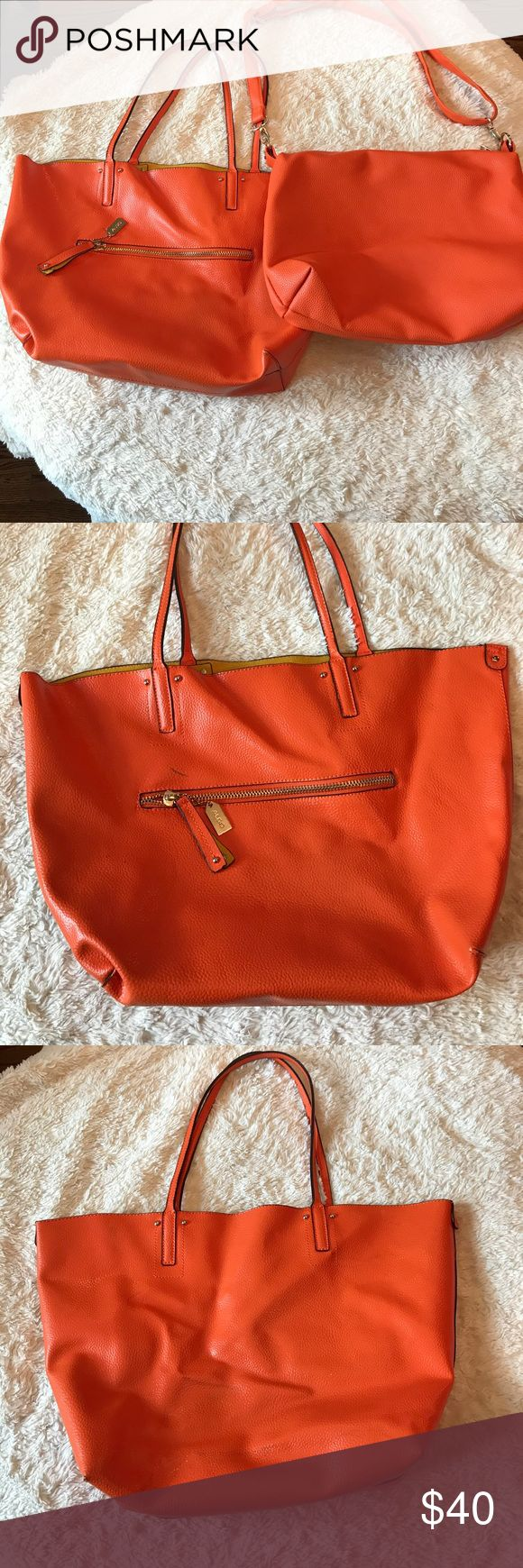 ORANGE Aldo tote bag DUO This listing comes with 2 bags.  One shoulder strap tote with the matching bag that can be worn inside the tote or separately.  Second bag has adjustable strap.  Note marks on tote bag  (pictured). Aldo Bags Totes