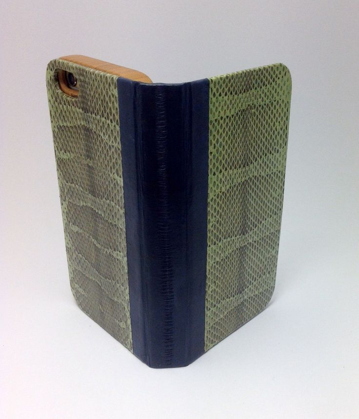 Handcrafted iPhone 6s case made of eel skin, snake skin, paper map, leather, and bamboo.