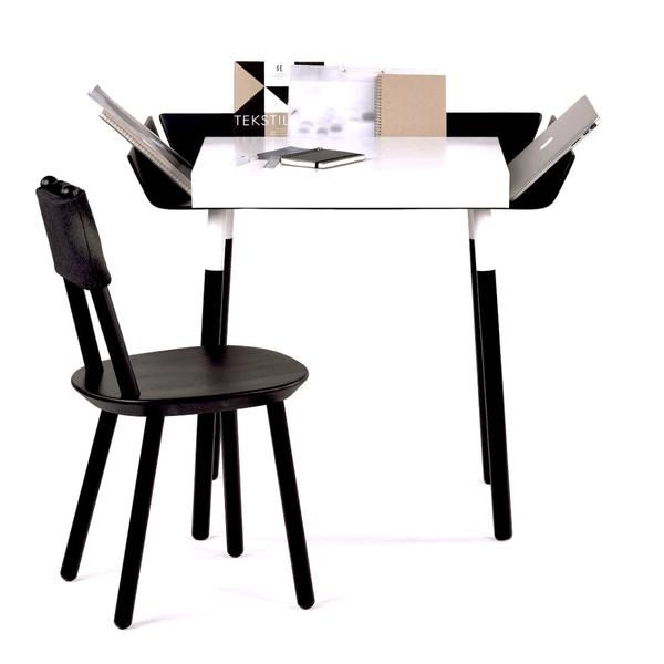 This Red Dot award winning My Writing Desk is made by EMKO. The contemporary black and white design has drawers and wings for organising and displaying items.