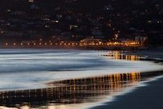 The reflection of the lights on St Clair Beach, Dunedin, New Zealand at dusk. Prints available starting at $49.