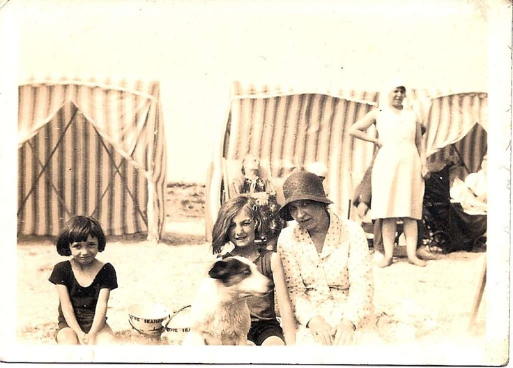 """My mother Margaret, my aunty Audrey and their mother Ivy Messer plus dog """"Timmy"""" at Canvey Island 1930s. (Also stern looking woman!)"""