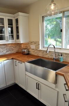 Butcher Block Countertops And Stainless Apron Sink.
