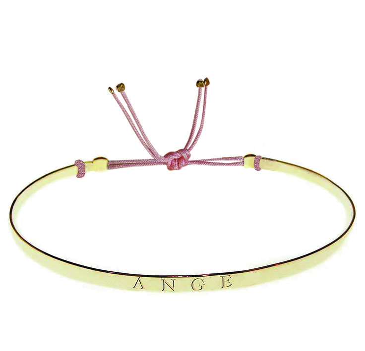Limitd edition of bracelets by Gag et Lou. Plated gold bangle attached to an adjustable colored string. Available in stores only