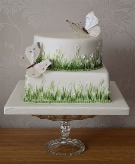 Nature lovers will adore this meadow inspired wedding cake, complete with edible butterflies.