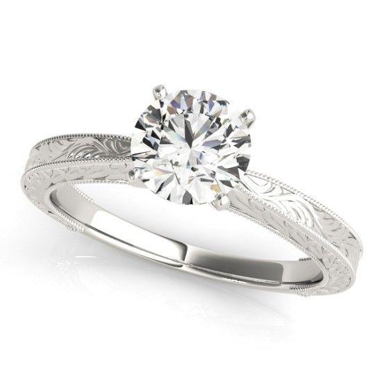''Victoria'' Sweet and Sparkly Vintage Diamond Engagement Ring Solitaire diamond engagement ring with vintage filigree and milgrain pattern.