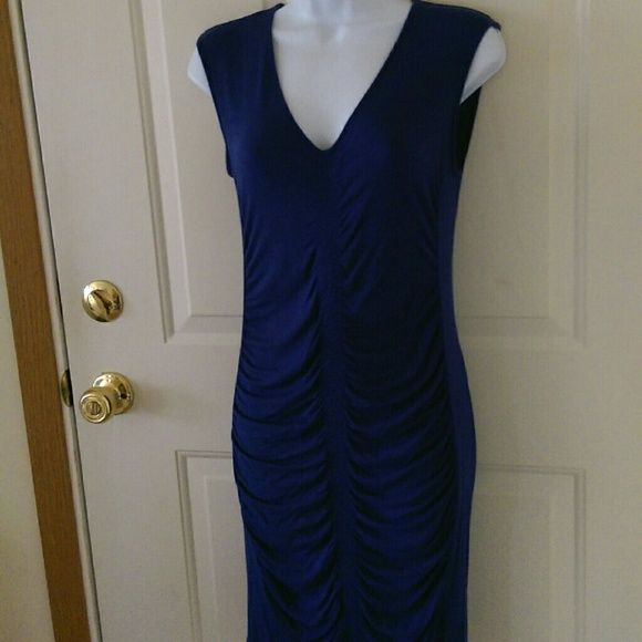 Blue Violet Kenneth Cole Dress Lovely dark blue violet dress from Kenneth Cole.  Dress has gather detail at the middle of the dress from top to bottom.  Dress measures 36 inches from top of shoulders to bottom hem.  Has been worn and washed but is in very good condition. 95% rayon, 5% spandex. Kenneth Cole Dresses