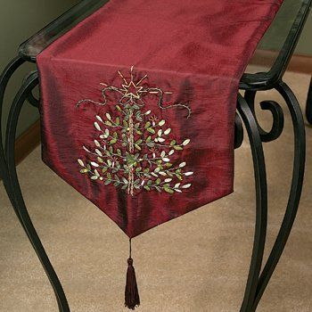 """Christmas Embroidered Tree Burgundy Table Runner 72"""" by OTC. $24.95. Rich Burgundy Looks Like Silk. 72""""L x 13""""W.. Dry clean only.. A beautifully elegant accent for Christmas. This rich burgundy table runner of lustrous polyester features ribbon embroidery in an elegant tree motif and is trimmed with silken polyester tassels. It would look stunning on your holiday table. Dry clean only. Imported. 72""""L x 13""""W."""