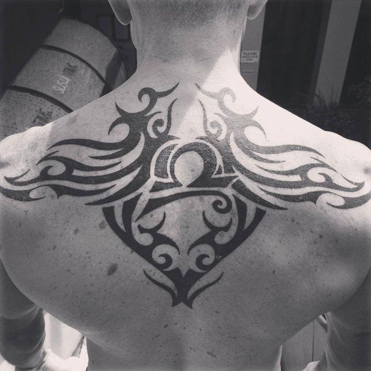 http://tattooideas247.com/tribal-back-tattoo/ Tribal Back Tattoo #BlackInk, #BulldogTattoo, #Tribal