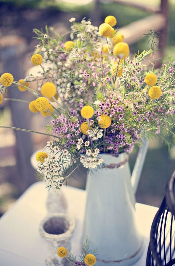 I would want some larger flower in the arrangement but I like the billy balls and wildflowers