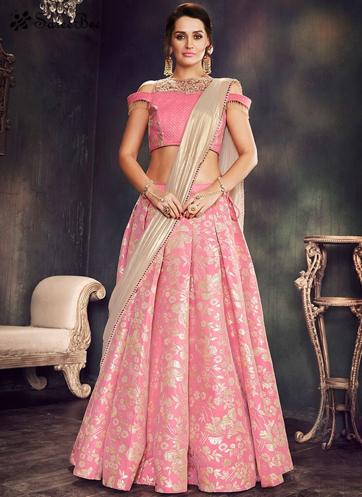 Opulent Brocade Pink Lehenga Saree  Rich look attire to give your a right choice for any party or function. Real beauty comes out from your dressing style with this pink brocade lehenga saree. This lovely attire is looking extra beautiful with embelishment of embroidered work. Comes with matching blouse.