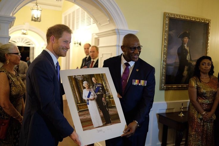 Prince Harry presents Sir Rodney Williams, the Governor-General, with a photo of The Queen & The Duke of Edinburgh 20 Nov 2016