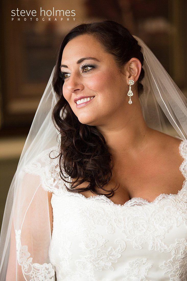 portrait of a brunette bride with sideswept hair and veil