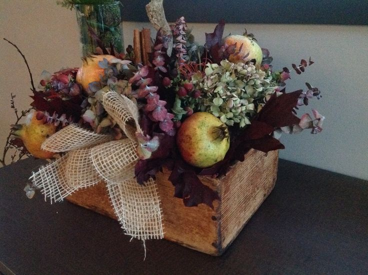 Old wood box. Autumm flowers and fruits