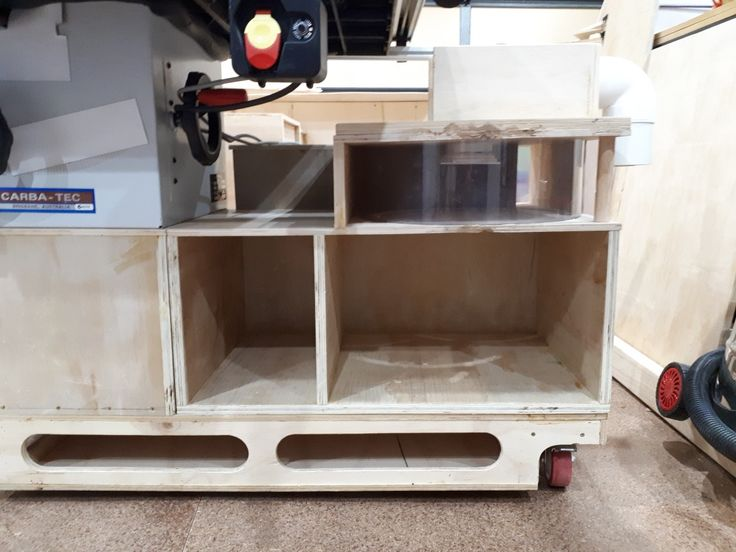 This is the front view of what will be a vortex dust collection with a manifold situated directly behind is allowing four inlet ports to connect the table saw, router, sanding station as well as a hand router station.