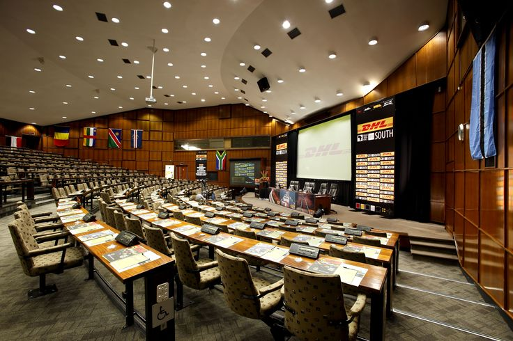 Raked theatre style seating with solid full length desks. The auditoriums have schoolroom style seating with podiums, soundproof interpreting and press booths as well as digital congress network units between each two seats