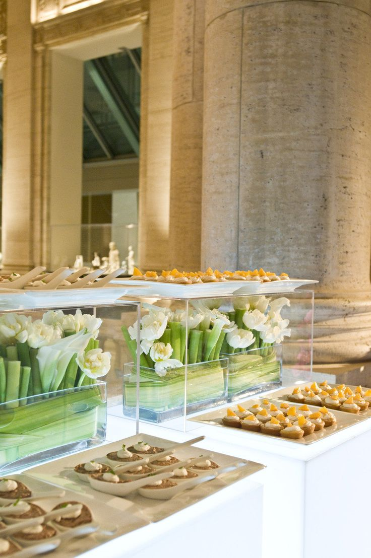 Super cool idea for food table at a wedding, maybe with some darker greens and roses inside?