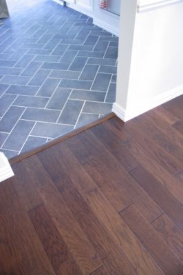 herringbone tile and wood transition.