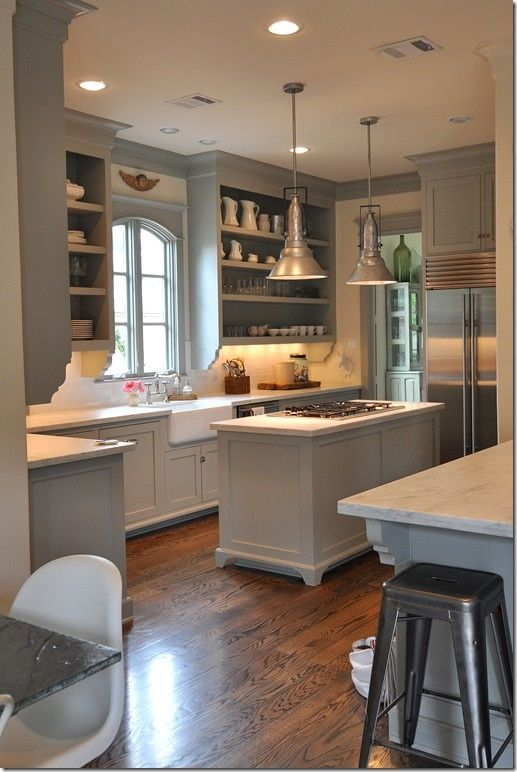 gray walls / white cabinets, doorless uppers, farm sink, lighting