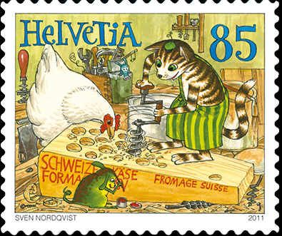 A Swedish cat making Swiss cheese. Findus, a Swedish children's book character, appears on Swiss postage.