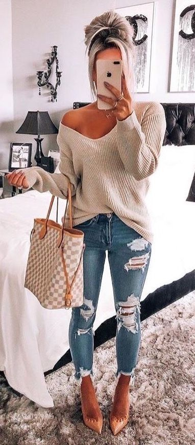 4129ecdbbb Cute off the shoulder knit sweater with trendy distressed denim jeans.