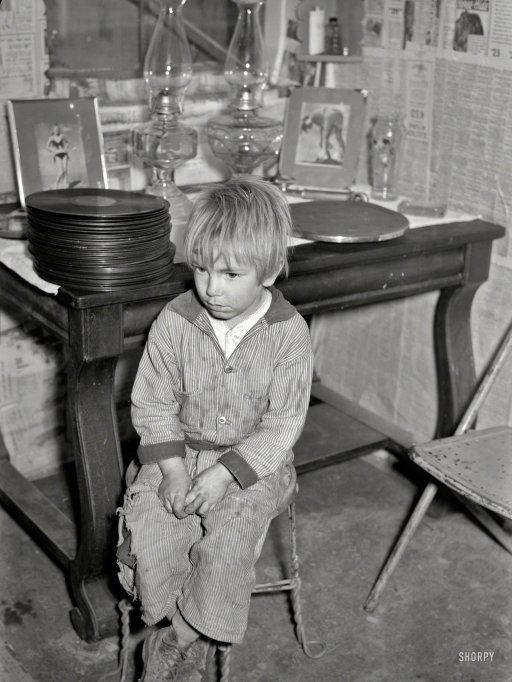 """January 1939. """"Boy whose father is on relief. Family living in shanty at city dump. Herrin, Illinois."""" Arthur Rothstein photo."""