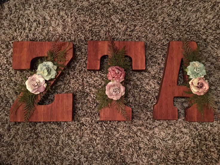 Zeta Tau Alpha wooden sorority letters made using wood stain and floral decoration.