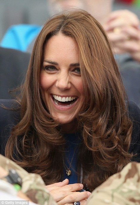 The Duchess of Cambridge laughed and joked with servicemen and women after taking her seat for the athletics at #Glasgow2014.