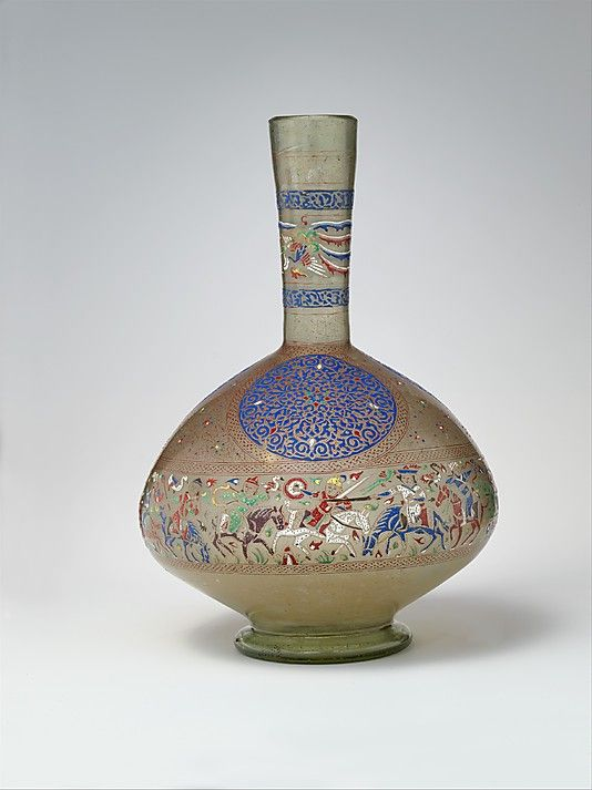 Bottle, late 13th century; Mamluk Probably Syria Greenish colorless glass, free-blown, enameled, and gilded; tooled on the pontil; red, blue, green, yellow, purple, brown, pink, white, gray blue, and black enamels; and gold; H. 17 1/8 in. (43.5 cm), Diam. 36 5/8 in. (93 cm) Rogers Fund, 1941 (41.150)