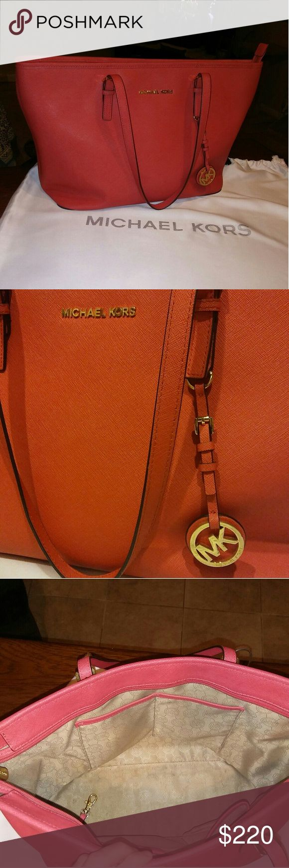 Coral colored Michael Kors shoulder bag Gently used, coral MICHAEL Michael Kors large shoulder bag. 5 interior pockets. Minor discoloration on the back due to storage (barely visible but pictured above) and small pen markings on interior pocket (also pictured above). Dust bag included. MICHAEL Michael Kors Bags Totes