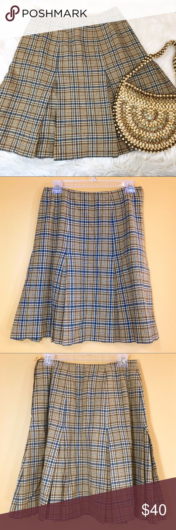 "Vintage 70's Plaid Pendleton Schoolgirl Skirt Oh my word, this skirt is adorable! Vintage 1970's yellowish tan and blue plaid Pendleton mini skirt with pleats. Skirt is fully lined.  Very Lolita schoolgirl!  Brand: Pendleton Size: 14 Made in the USA Material: 100% wool  Condition: good, pre-owned vintage.  Measurements (flat): Waist: 14"" Hips: 18"" Bottom hem: 50.5"" Length: 21"" Pendleton Skirts A-Line or Full"