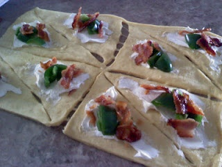 Jalepeno Popper Crescent Rolls:  Bacon, cream cheese, jalapenos in a cresent roll
