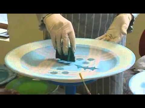 http://www.tainpottery.co.uk - Watch as the skilled worker hand paints a Tain Pottery plate from start to finish. All the tricks of the professional's trade