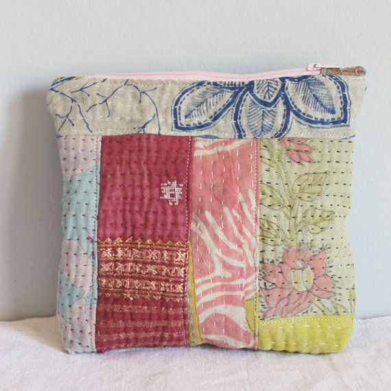 Great pouch for any type of occasion, birthdays and a particularly unique bridesmaid gift.  This purse/pouch us the perfect size to keep things orderly. This bag can be used for makeup, business cards, bills to be paid, receipts, jewellery and the list goes on. They also make the perfect gift. Great to carry small sewing projects around or use as a pencilcase!  This has been made with vintage kantha quilt remnants. It is lined with a lovely turquoise Tilda fabric fabric. It has a zipper…