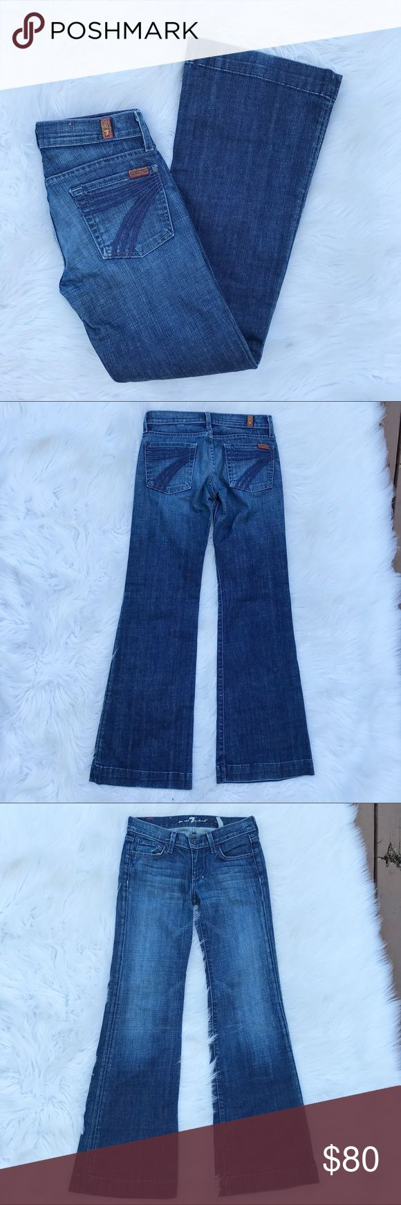 """7FAMK DOJO Lexi Petite Tailorless Dojo jeans by 7FAMK, Lexie Petite. In excellent used condition. Medium/ dark wash. Very very little wear to bottom edges. 98% cotton, 2% spandex. Inseam - 30"""", rise - 7"""", bottom leg opening - 10"""", waist - 14.5"""". No trades, offers welcome. Cover photo most accurately shows color. 7 For All Mankind Jeans Flare & Wide Leg"""