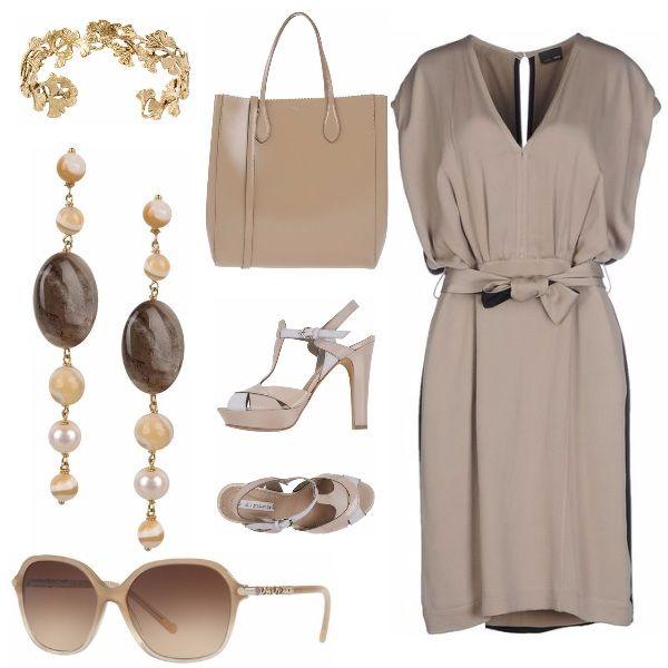 Abito semplice, arricchito da gioielli raffinati. La borsa capiente arricchisce l'outfit che può essere utilizzato anche per un appuntamento di lavoro.