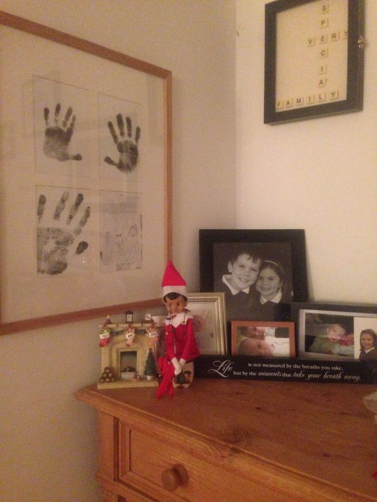 Eliot hung the stockings on his fireplace