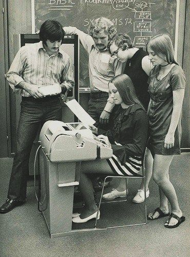 Computer Class - 1972.  I even had a guy who looked exactly like that in my classes.  Weren't those sandals called Water Buffalo Sandals?  You soaked them in water, wore them wet until they conformed to your foot.